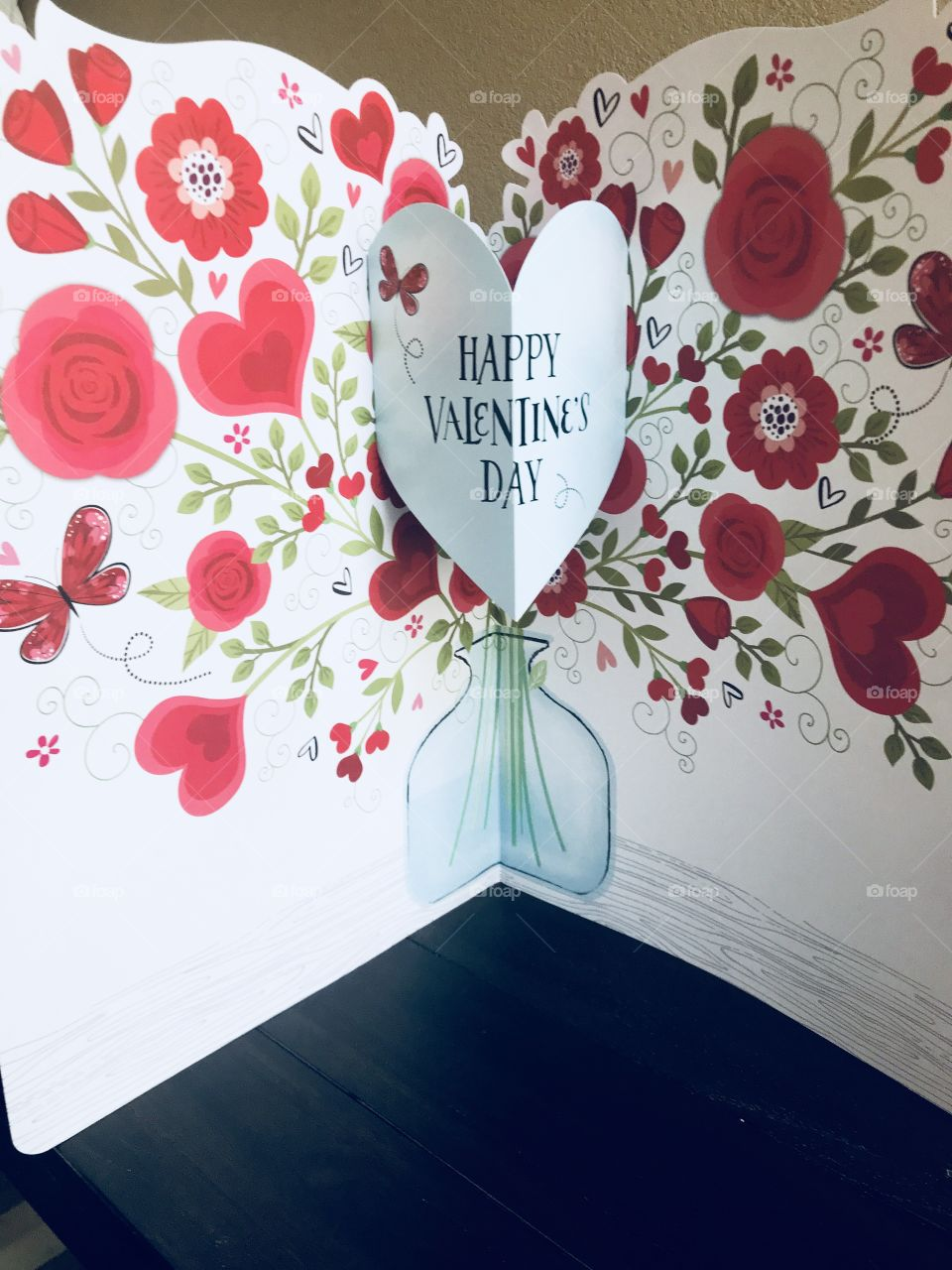 A happy Valentine's Day card with hearts, flowers and roses  celebrating Valentine's Day for your sweetheart. USA, America