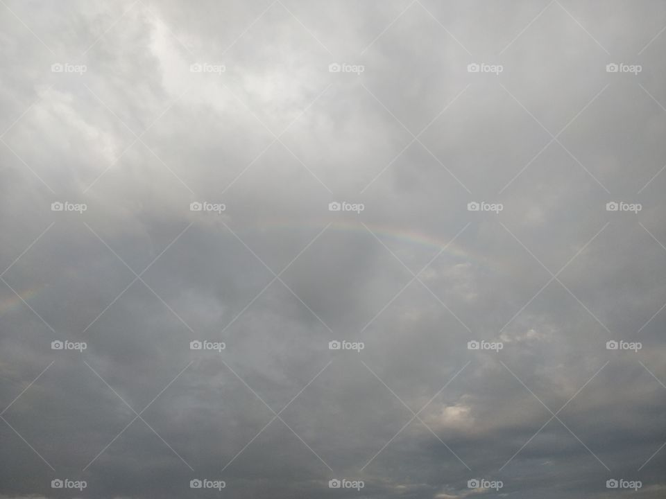 semi circle rainbow just likely to be visible ong the smoky clouds