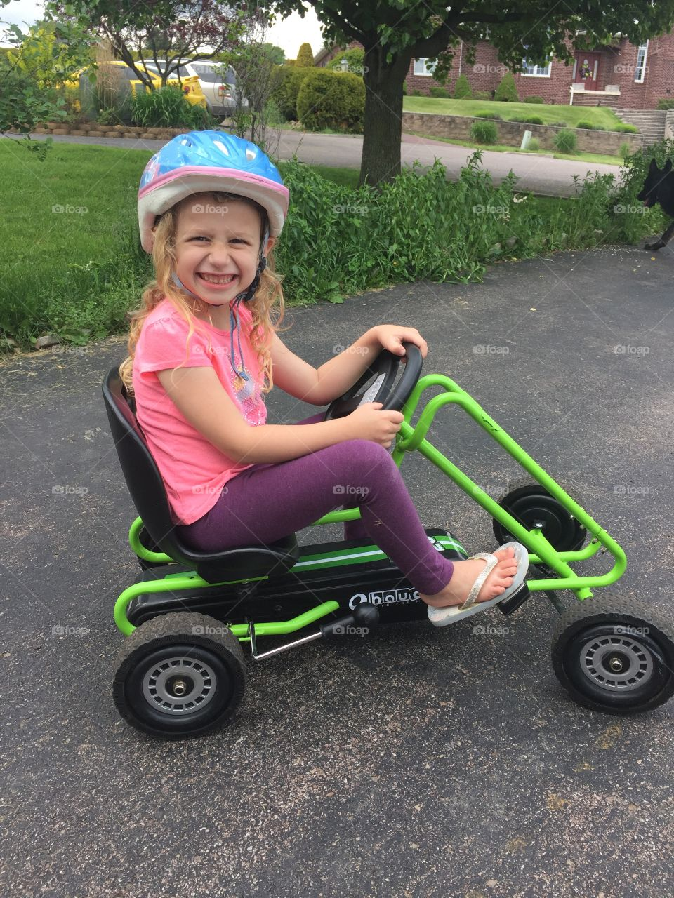My five year old daughter happily biking along.