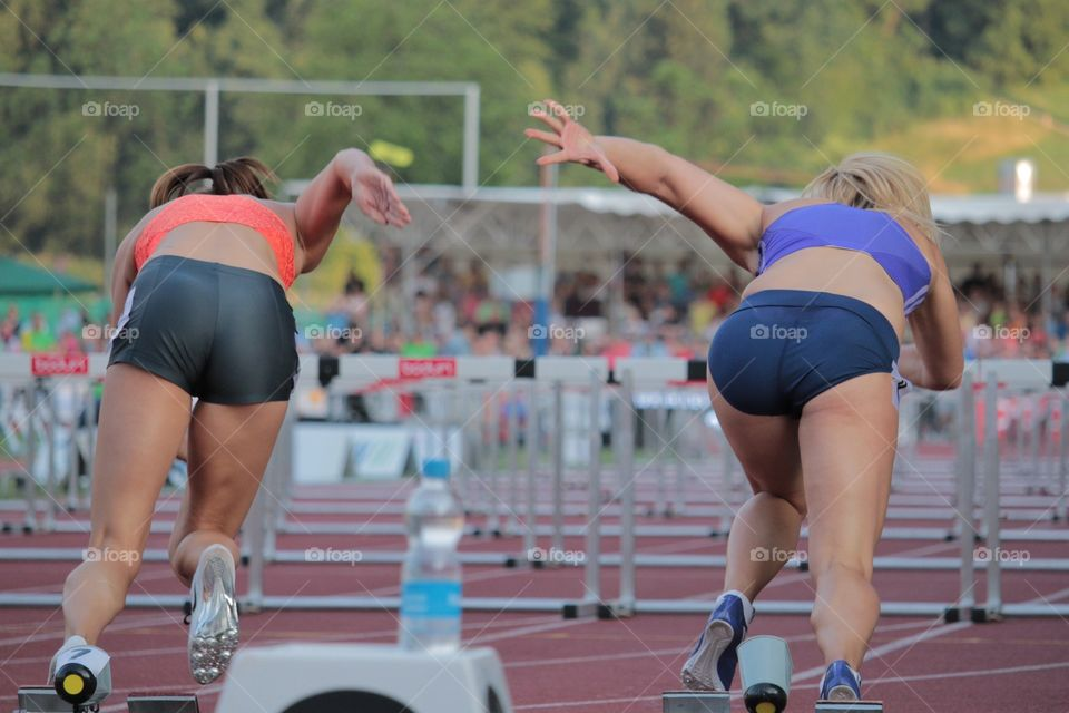 Female Sprinters Taking Off. Sprinters Clelia Reuse and Sarah Laving taking off in Luzern Meeting 2015