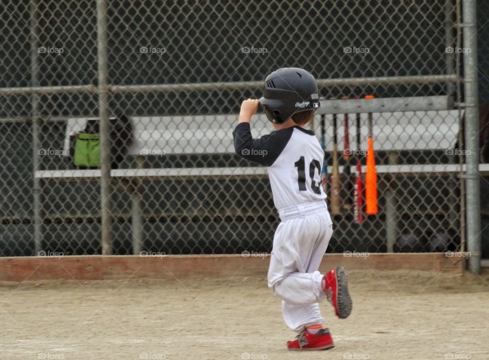 Young Baseball Player. Young T-Ball Player Running The Bases