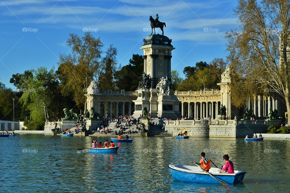 Enjoying spring at the lake in. Enjoying spring at the lake in Buen Retiro Park, with Monument to king Alfonso XII in the background