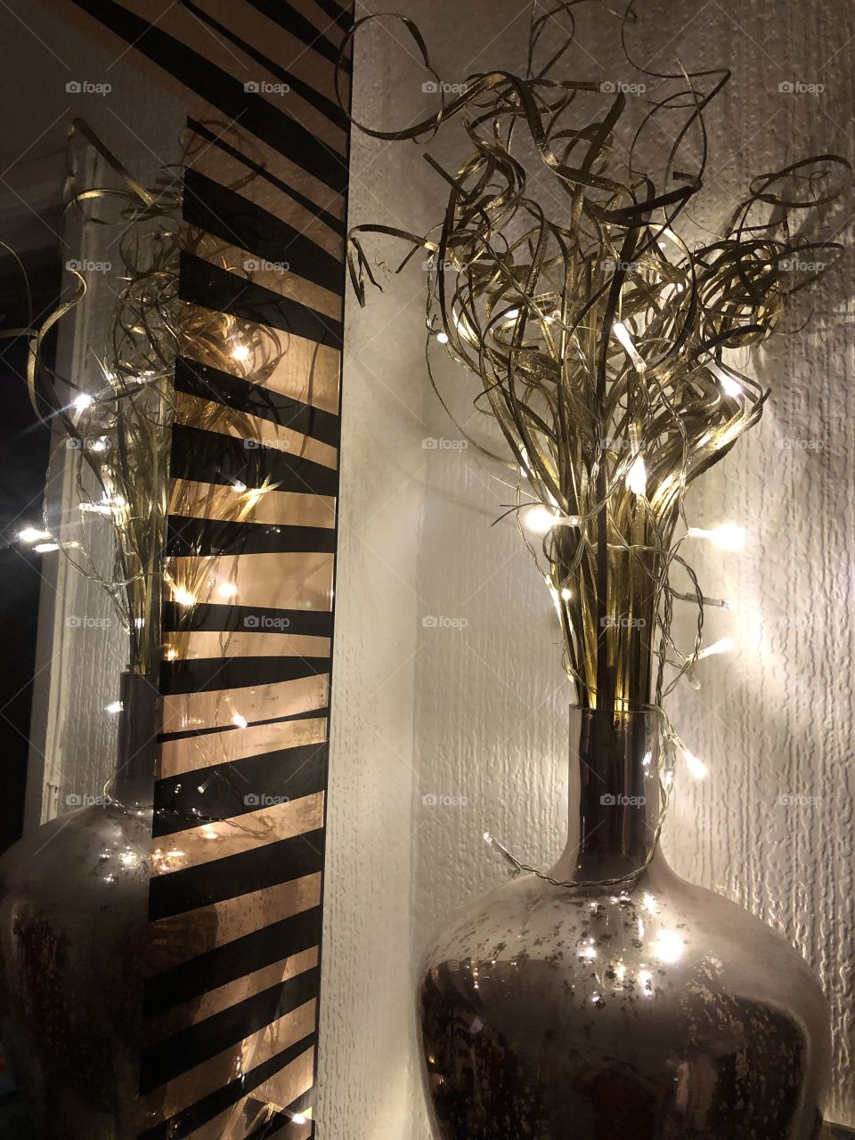 Fairy lights and vase reflecting in the mirror