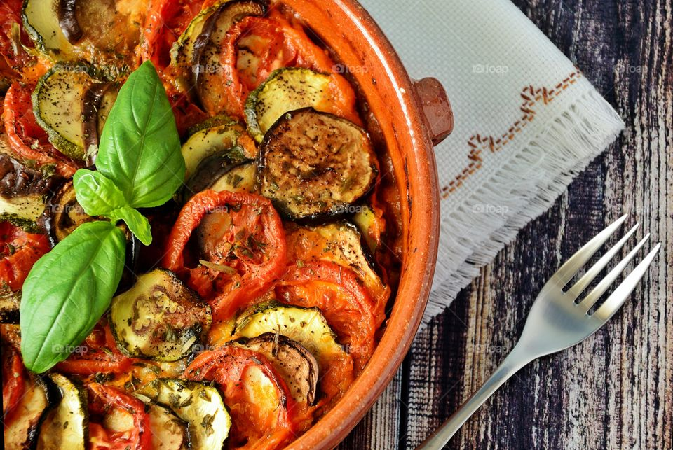 Eggplants and mini peppers in cooking pot