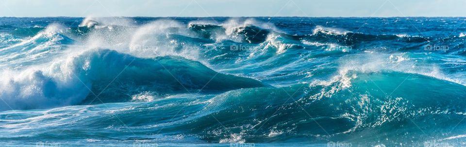 Waves in blue sea