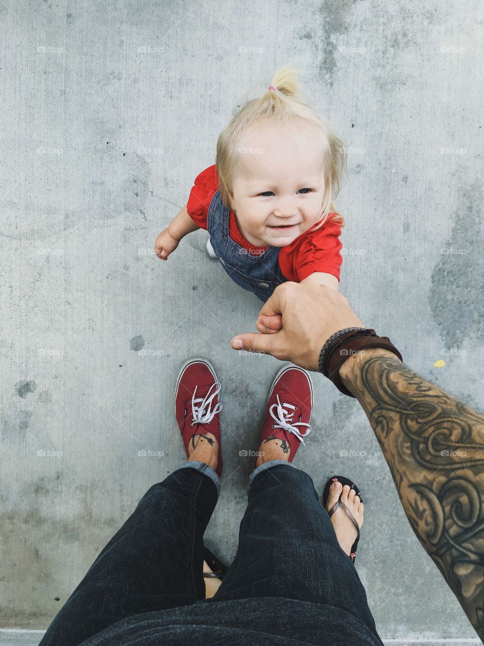 A cute daughter holding his father's hand