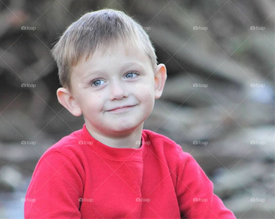 This adorable little boy with his bright blue eyes, and charming little grin, stole his mother's heart.