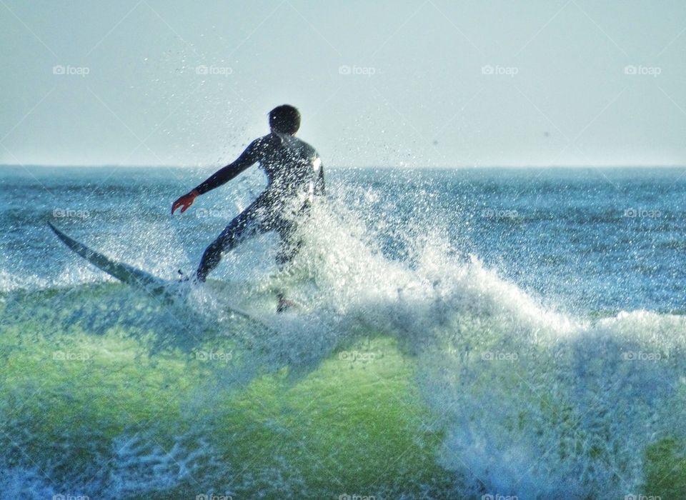 Skilled Surfer Cresting A Big Wave. Big Wave Surfing