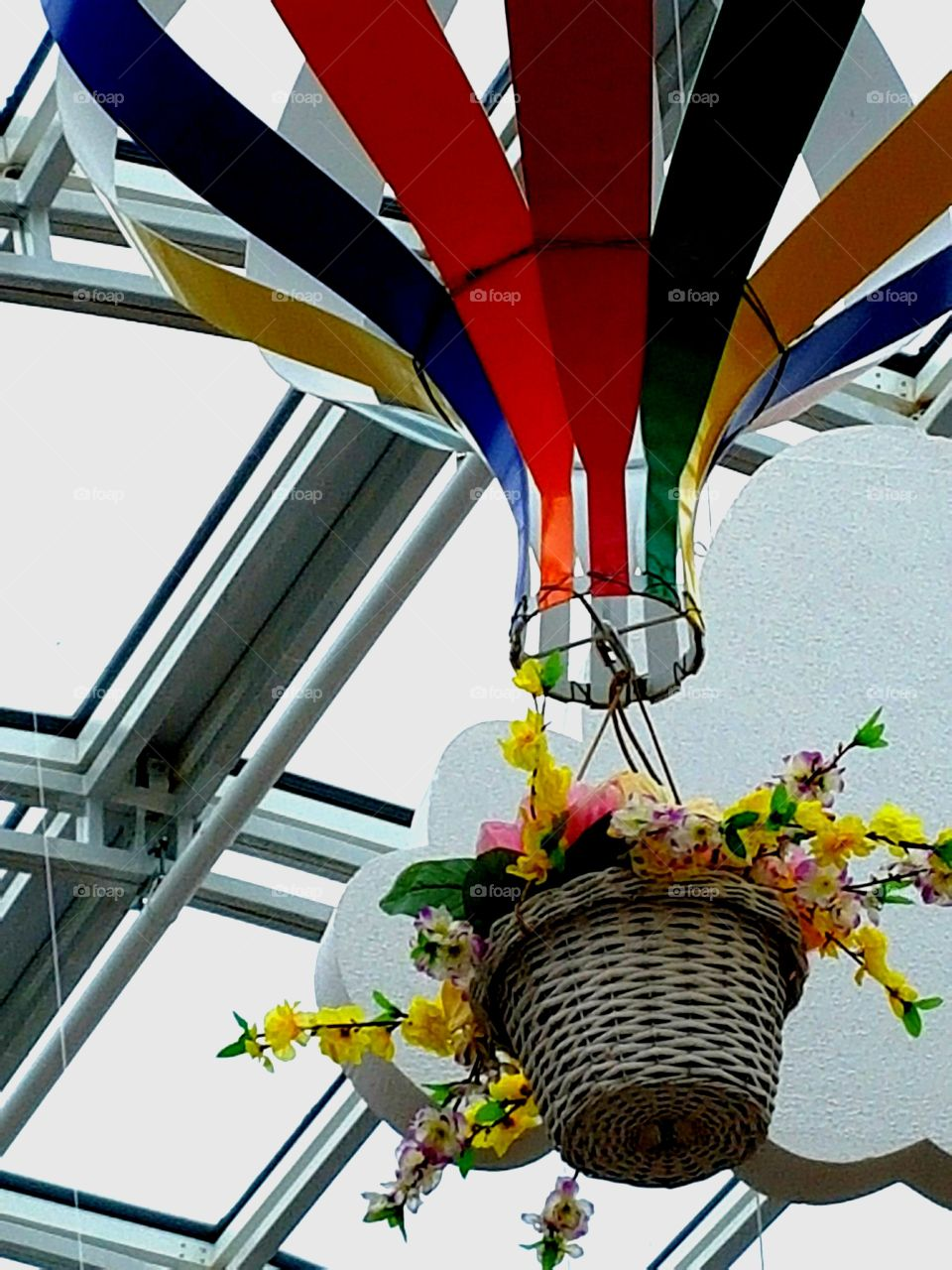 basket with flowers under the roof