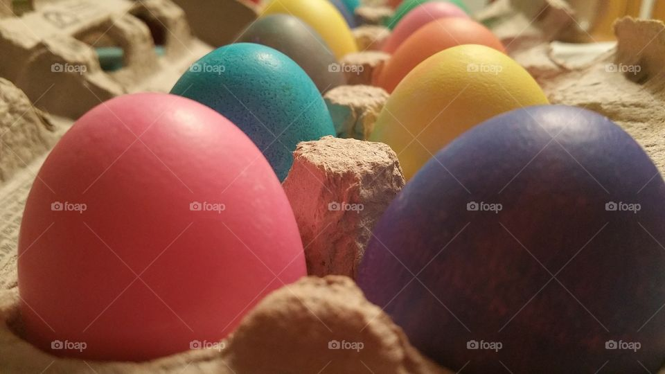 Multi colored egg in carton