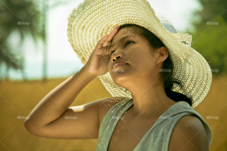 lady out on the sun. asian woman enjoying spring