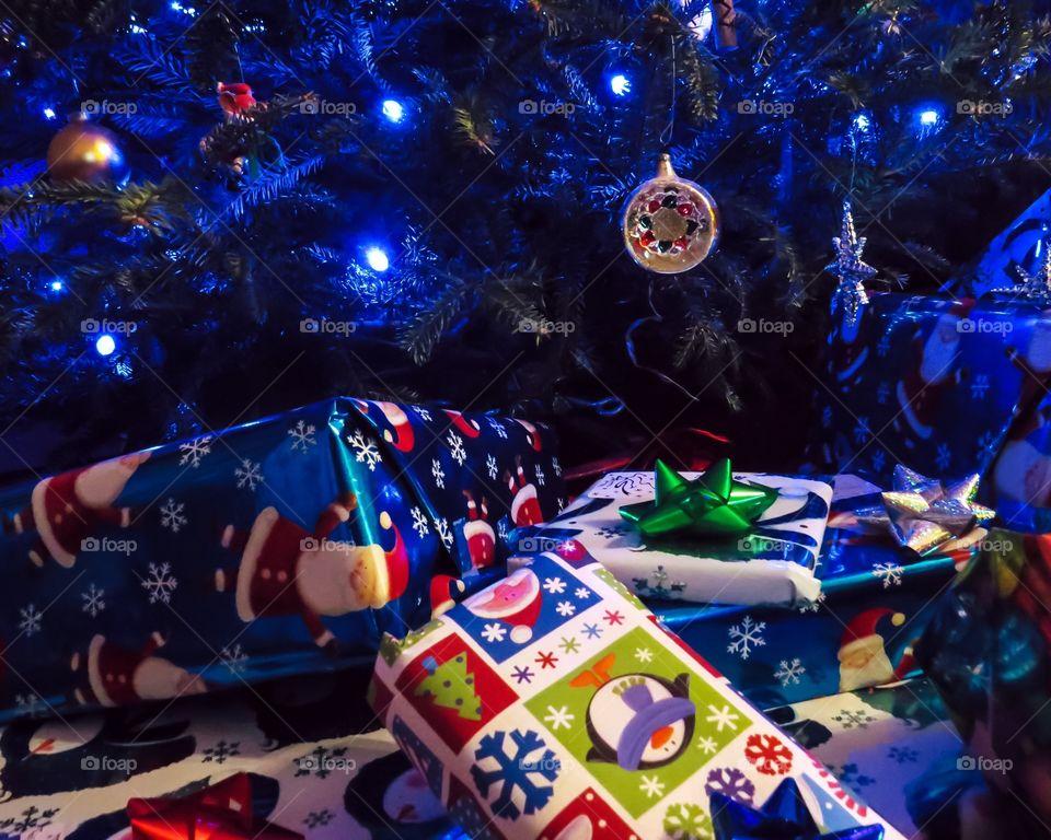 Gift boxes near christmas tree