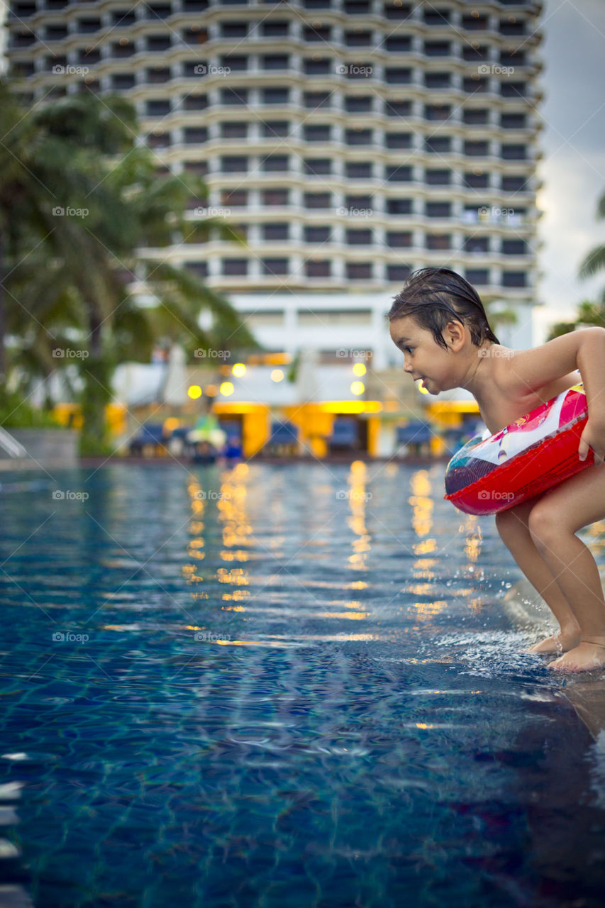 Young boy ready to jump into the pool. Thitiwin on holidays