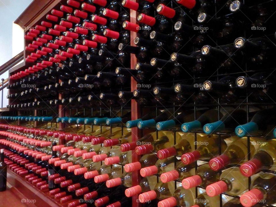 Wine bottles stacked on wooden racks