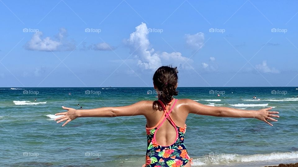 Child looking at Miami Blue Sea