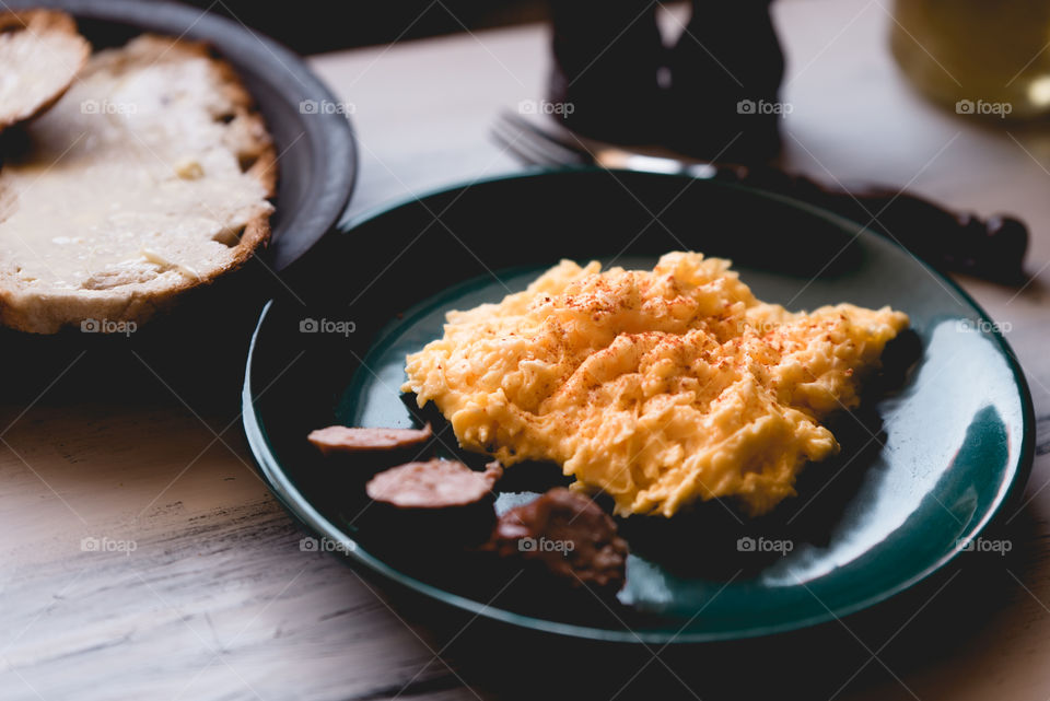 simple, traditional Polish breakfast. fresh eggs with butter, fresh bread, sausage