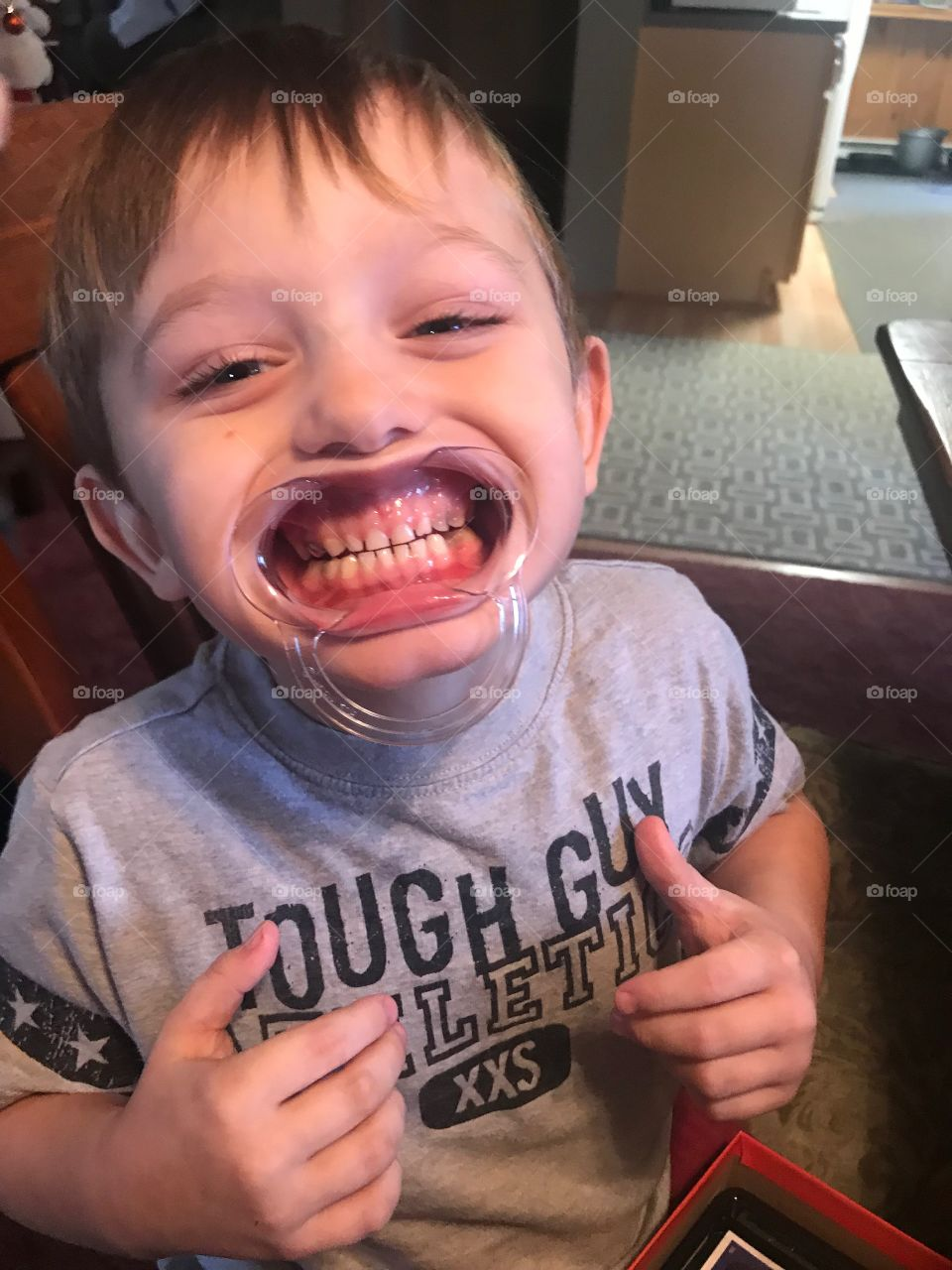 A wide mouthed cute little boy playing a silly game that makes us giggle.