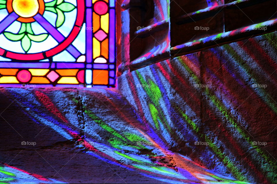 multi color reflection on the ancient wall