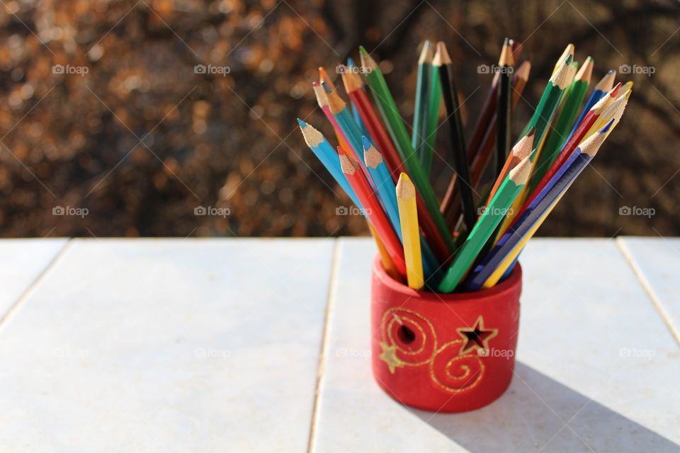 coloured crayons in a Christmas holidays decoration holder