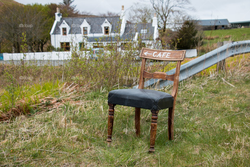 Wooden chair on the grassy land