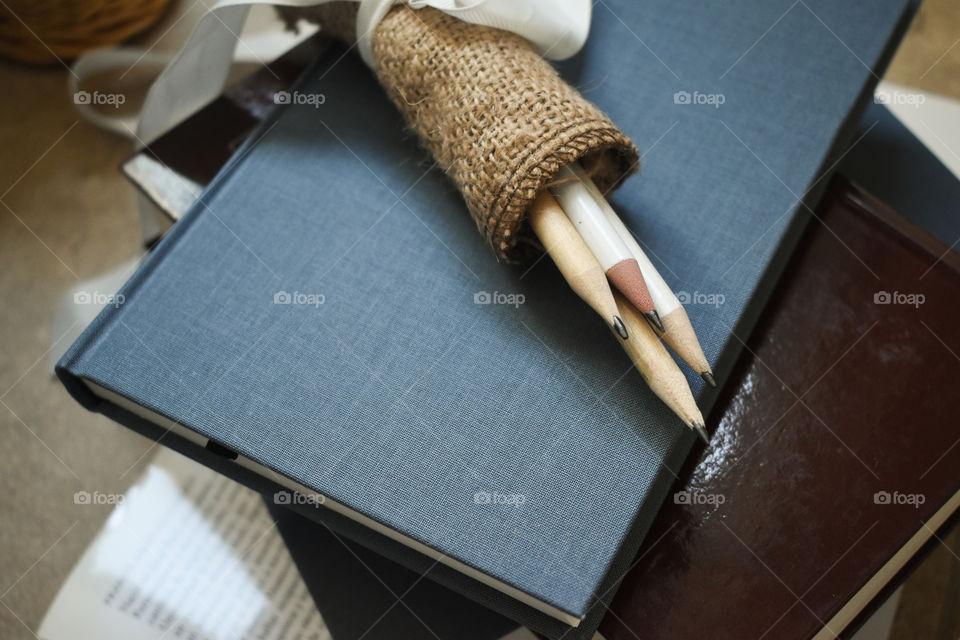 Graphite pencils on the books