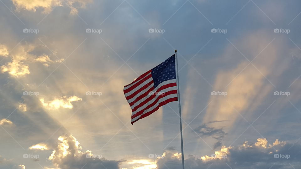 American flag. American flag with a sunset backdrop