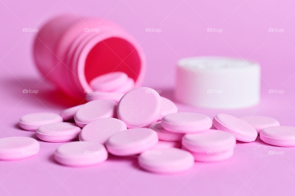 Pink tablets on a pink background