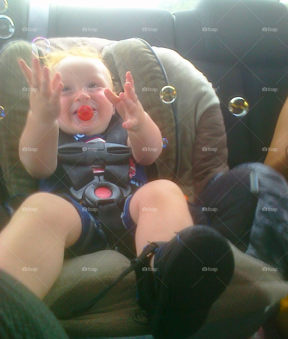wee bubbles. my grandson being occupied on our way to dinner about a 35 minute trip