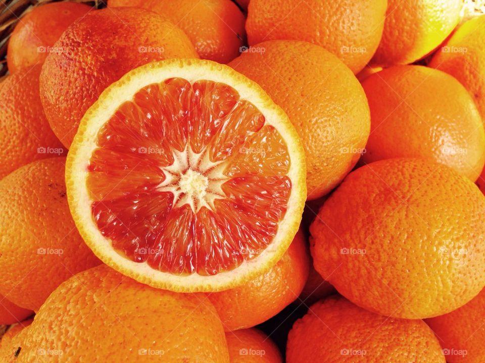 Close-up of sliced orange and oranges