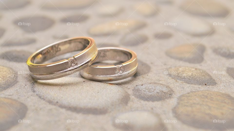 a pair of wedding rings in vintage color tone