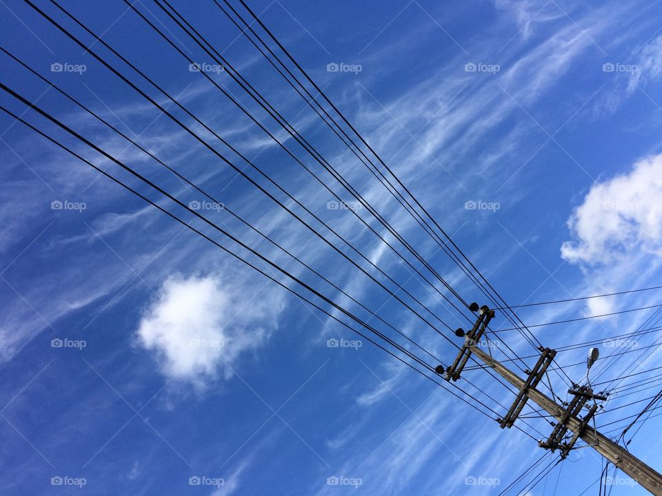 Power Lines Against a Blue New Zealand Sky