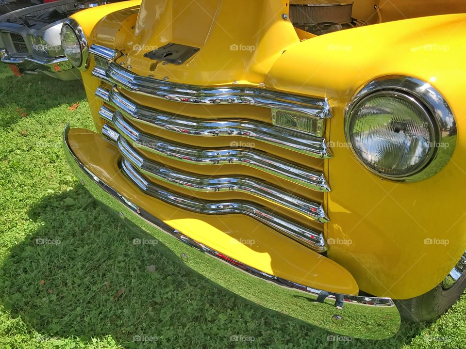 Bright  Yellow chevy car side grill view