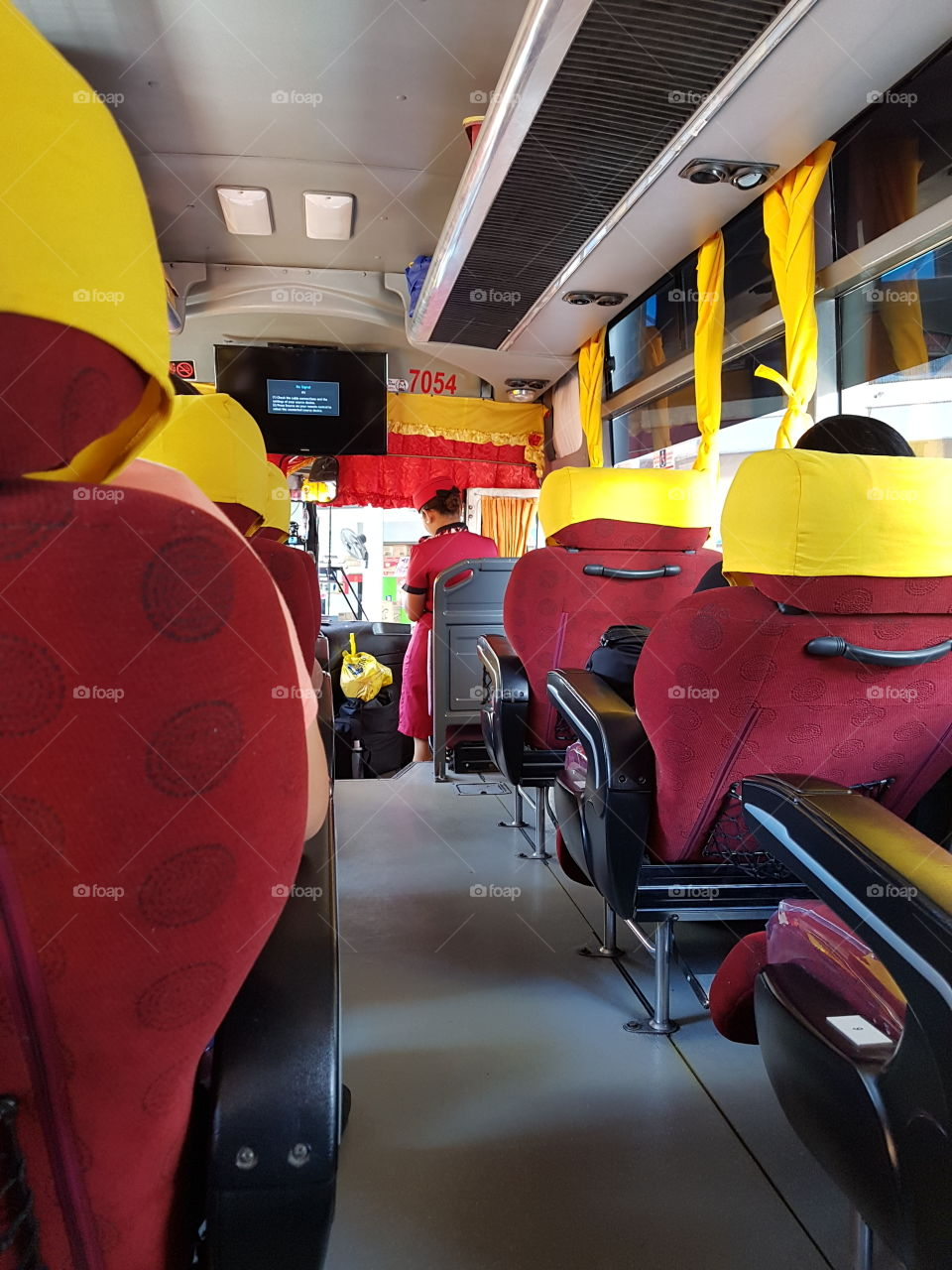 Bus interior of a deluxe vehicle. The inside of this bus is provided with a comfort room. Convenient for passengers use.