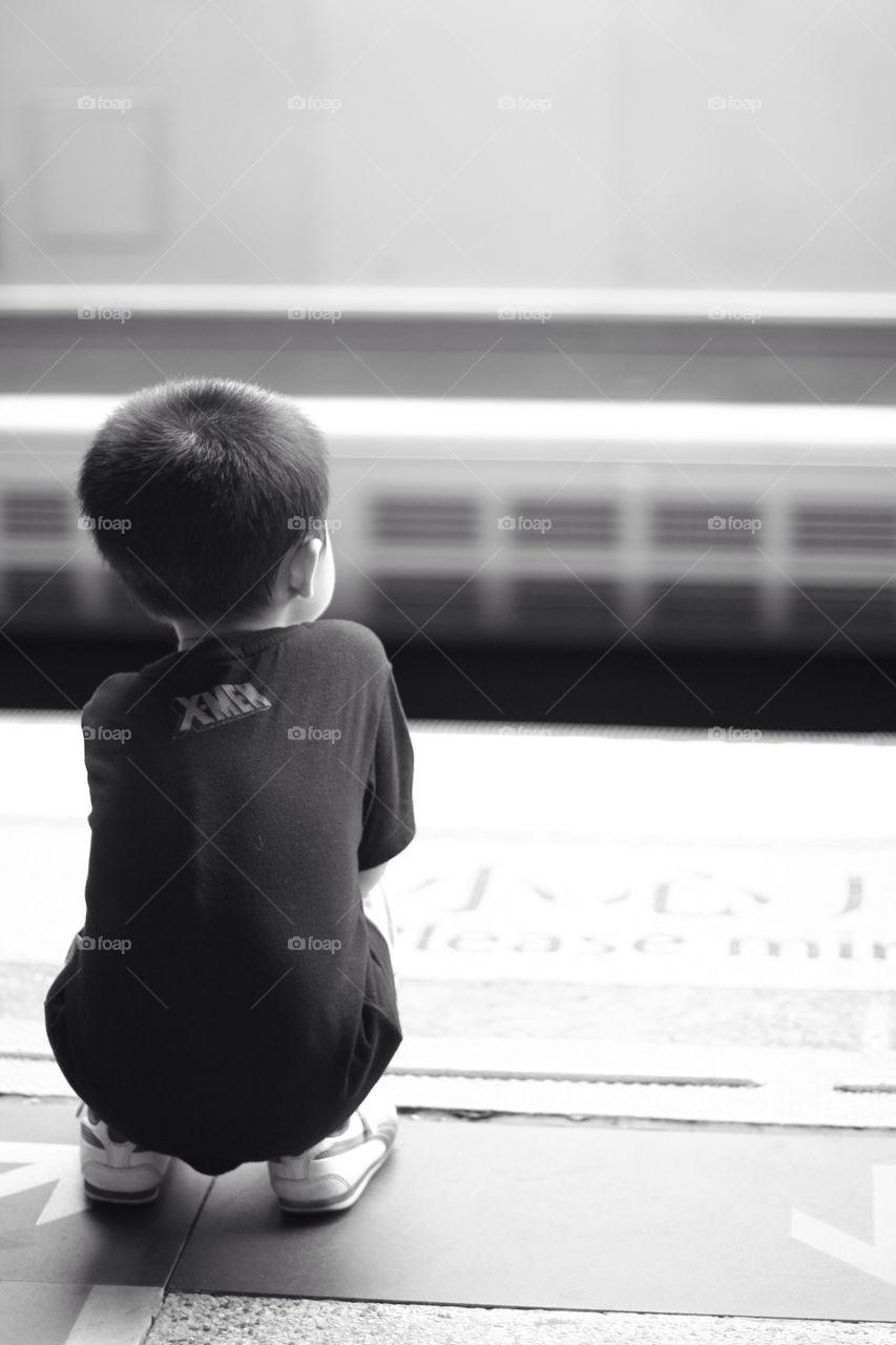alone child train boy by fostertown