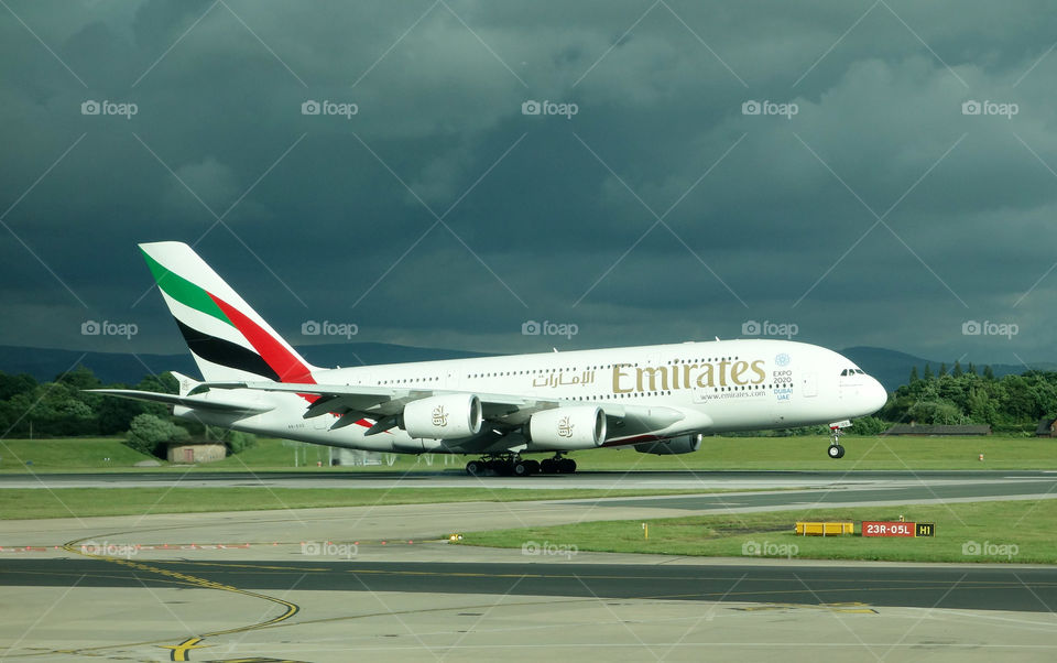 An Emirates Airbus A380 lands at Manchester Airport