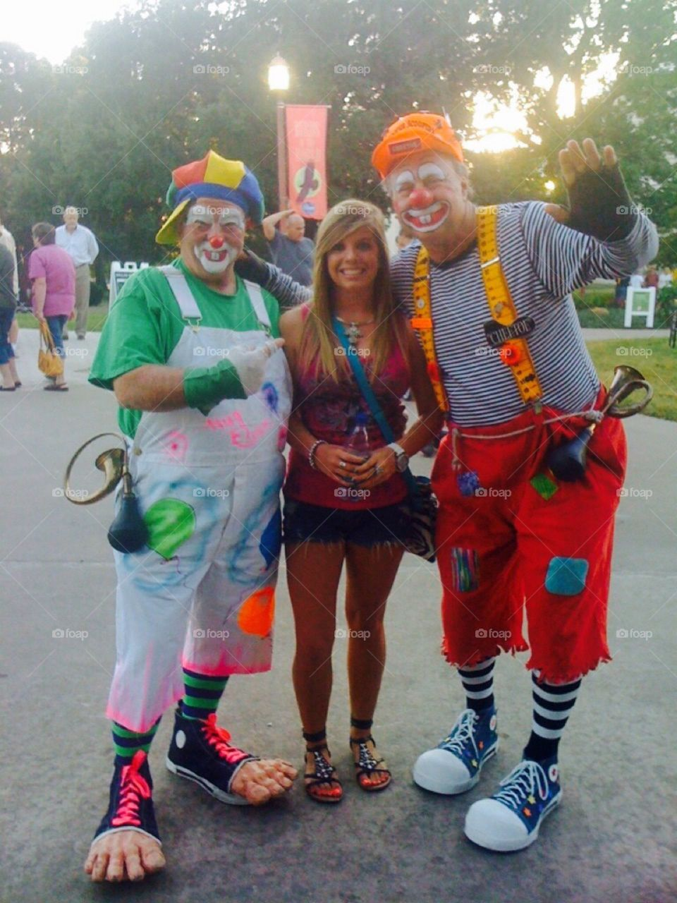 Portrait of men in face paint standing with young woman
