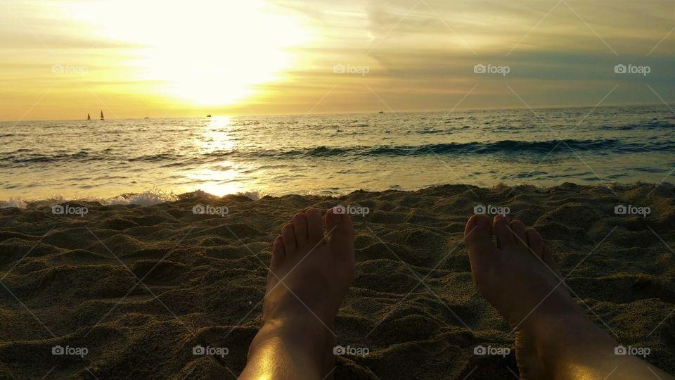 Feet in the sand at Redondo Beach