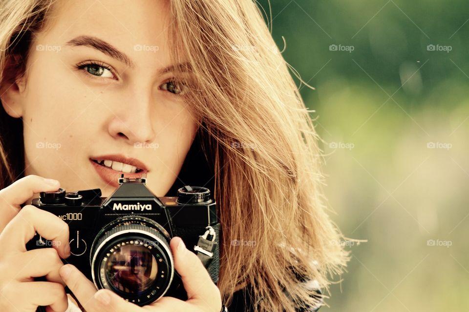 Girl with an analogue camera