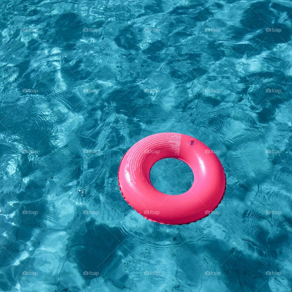 Inflatable ring floating on water