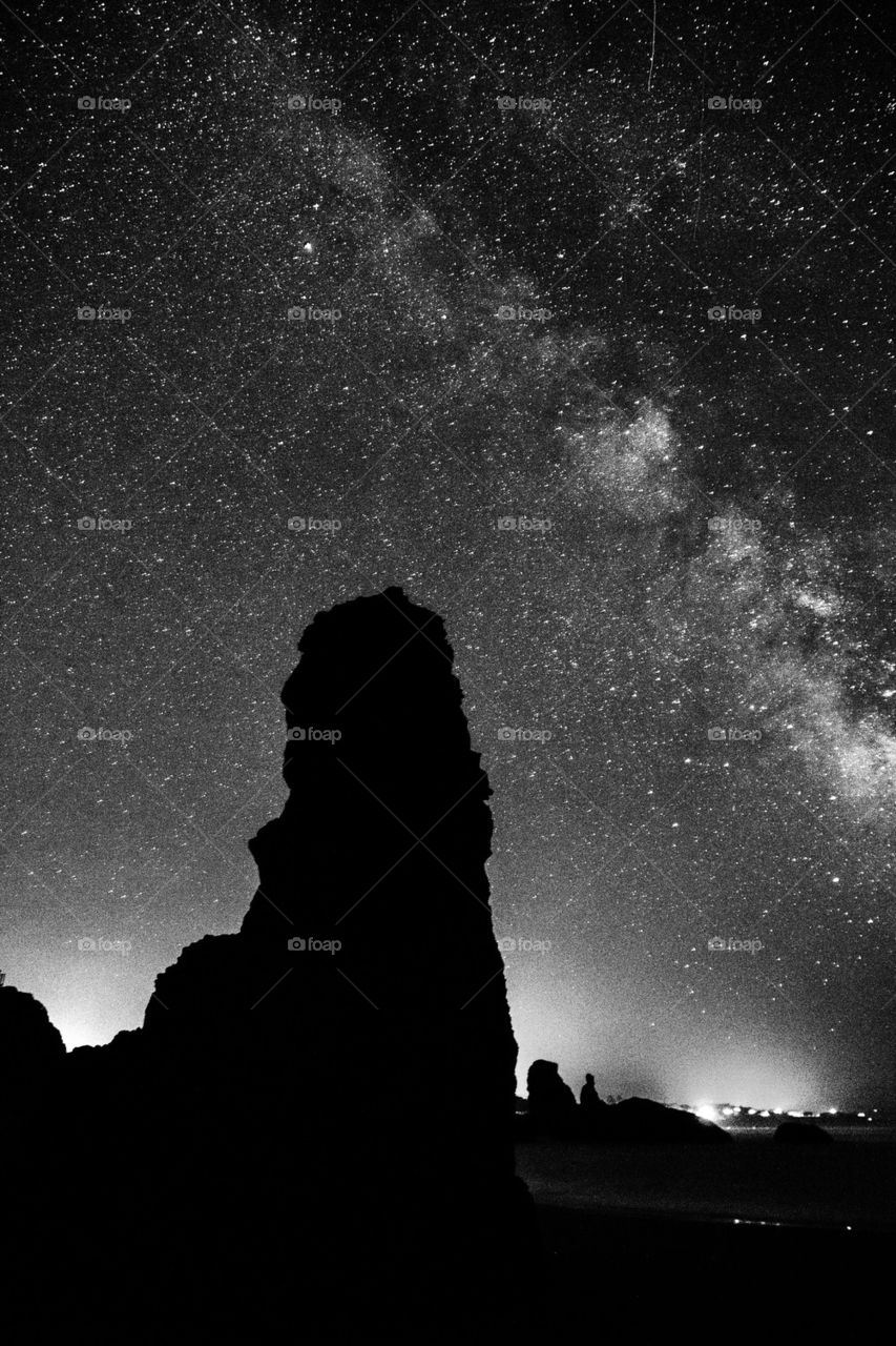 Silhouette of rock formation in milky way