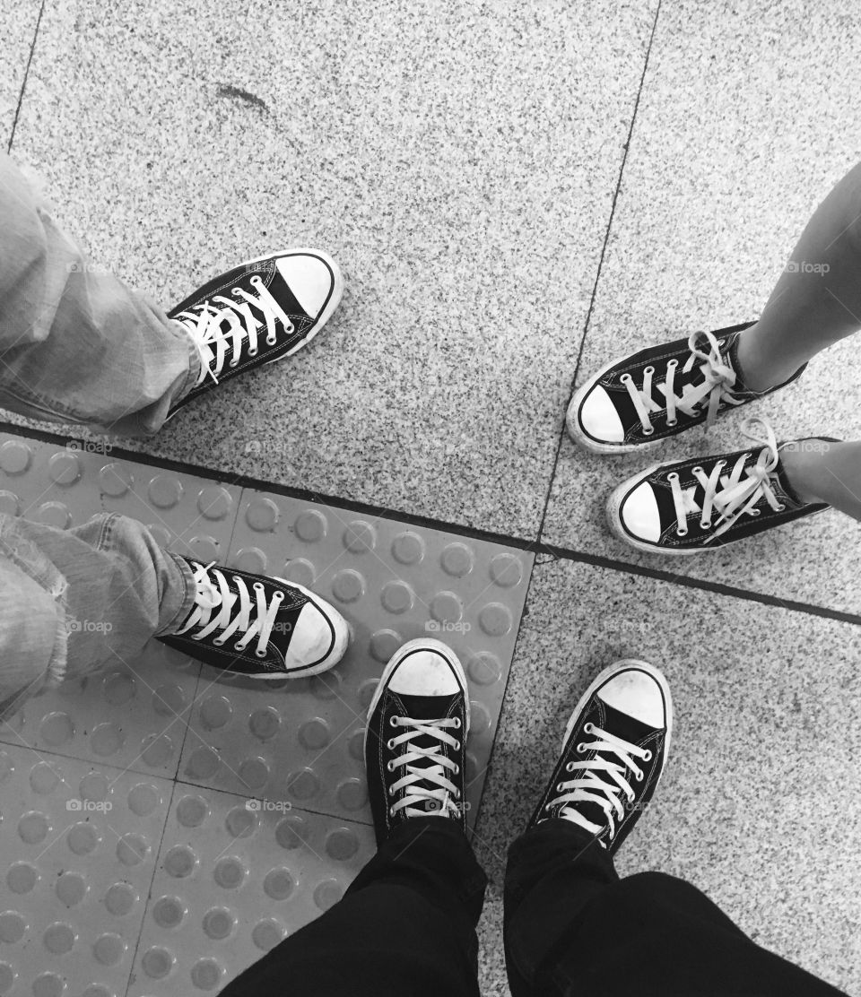 Three People Wearing Canvas Shoes