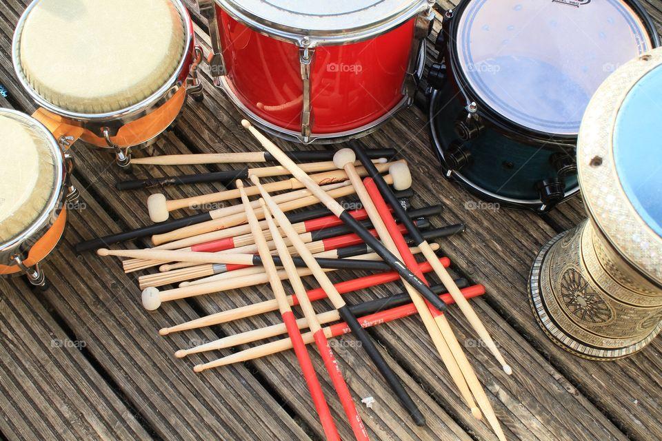 Various drumsticks and drums