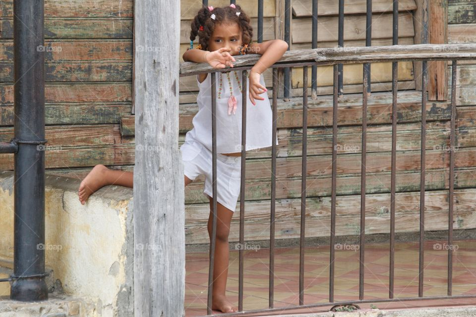 Cuban People.Little girl on the front porch of her house.