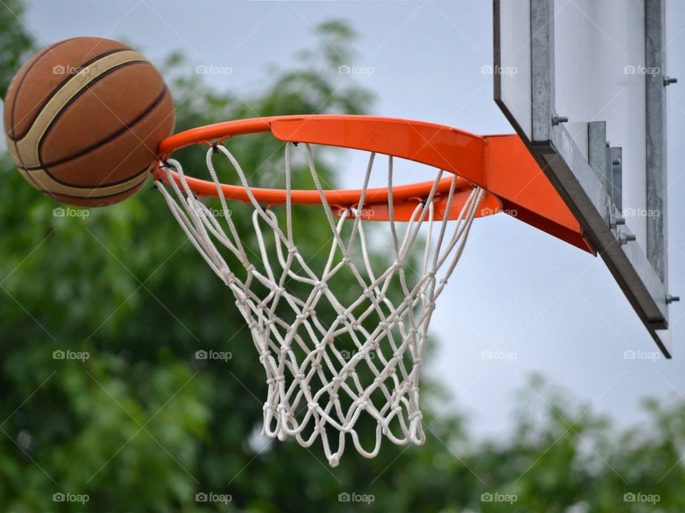 Basketball near hoop