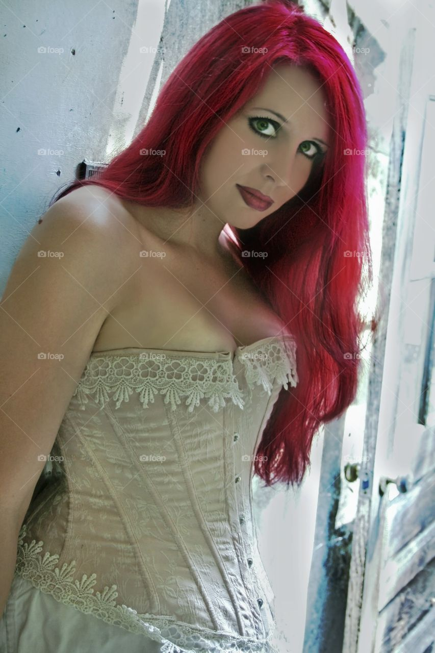 Portrait of gorgeous sensual woman with red dyed hair