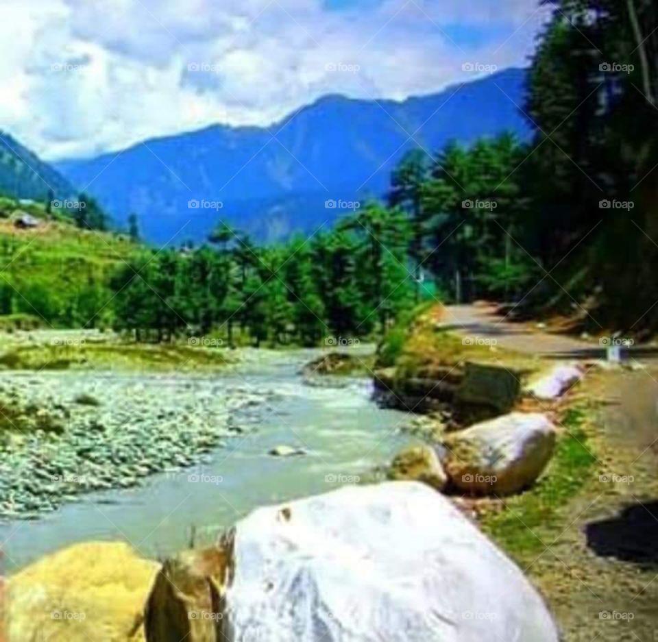 serene ... brook, pebbles, stones, rocks .. mountains. Otw to Palhagam, Kashmir