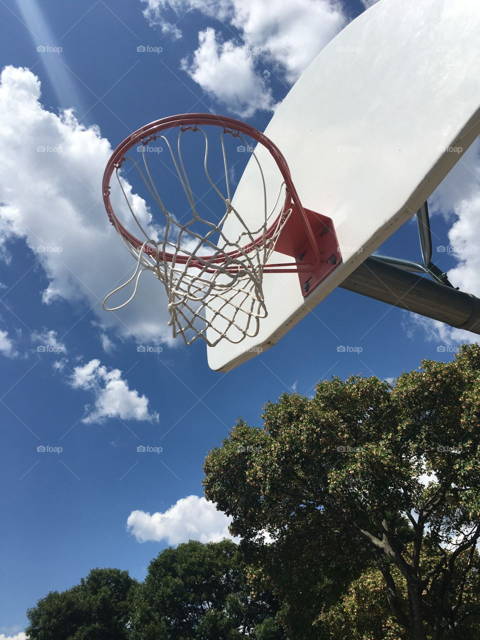 Basketball Net and Blue Sky with Clouds 2