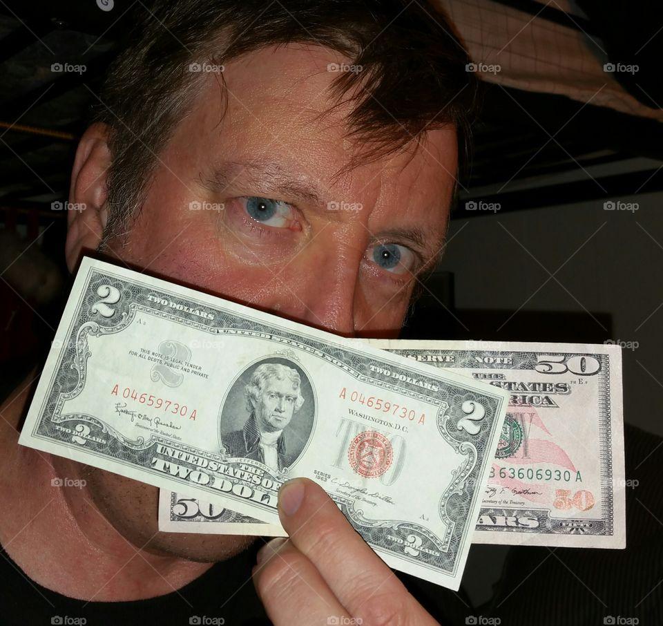 Man holding american dollars