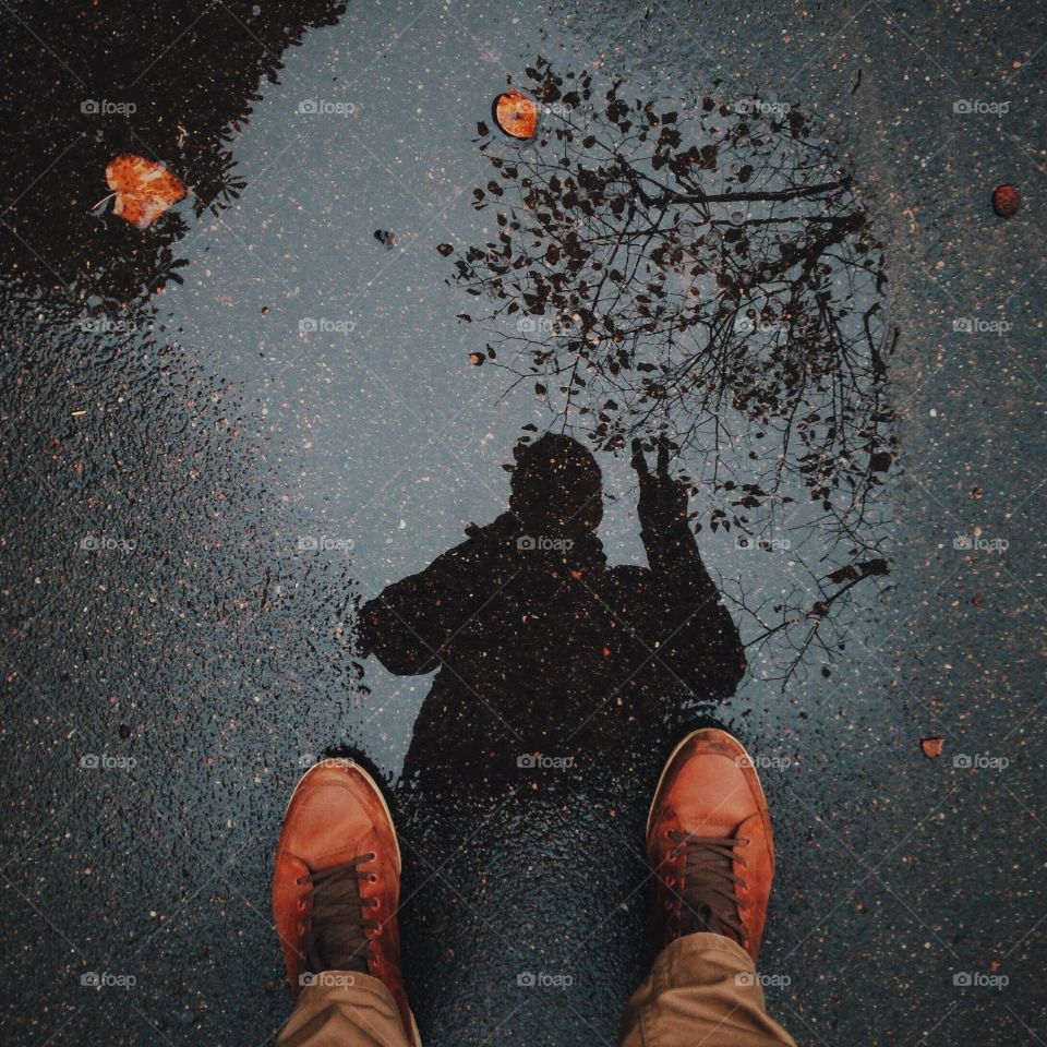 Reflection of a man on the street