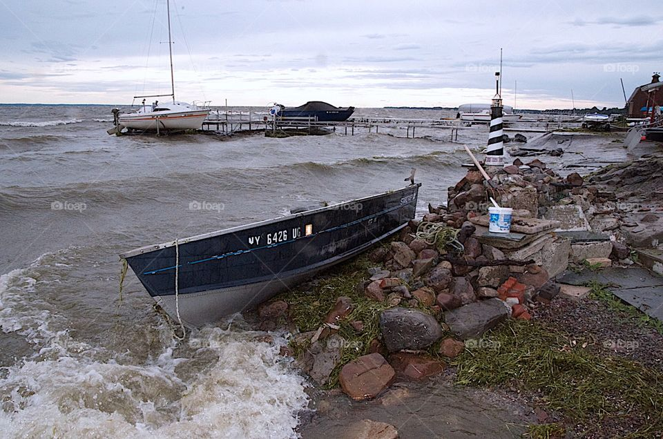 The old trusty row boat was tossed out of the boat hoist  and smashed onto the rocks. Fall came early that year and took us by surprise.